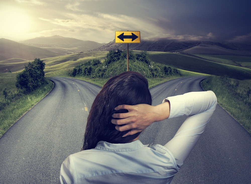 woman in front of two roads deciding which industrial mixer to choose