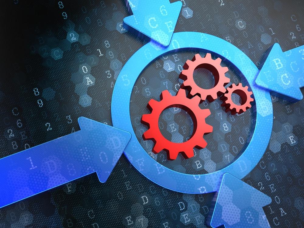 Cogwheel Gear Mechanism Icon Inside a Target on Digital Background IMPROVE YOUR POWDER HANDLING PROCESSES TO INCREASE ROI