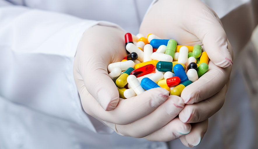 Pharma hands in design of pharmaceutical manufacturing plant